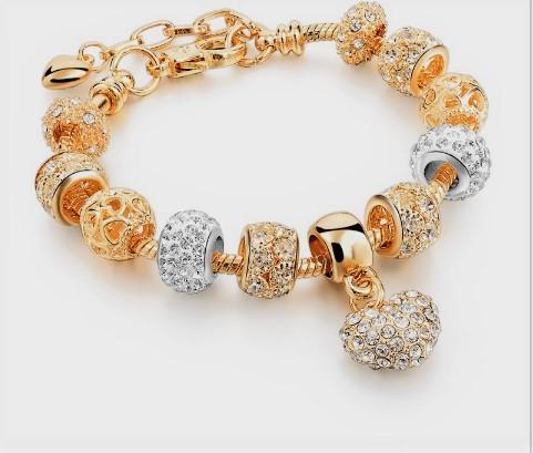 пандора зі срібними і золотими намистинами